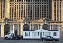 Mike Kelley. The Mobile Homestead in front of the abandoned Detroit Central Train Station, 2010. � Mike Kelley. Photograph by Corine Vermuelen