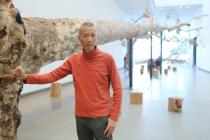 "Cai Guo-Qiang in front of his installation ""Eucalyptus"" at the Gallery of Modern Art, Brisbane, Australia, 2013. Photo: Yuyu Chen, courtesy Cai Studio."