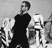Portrait of the artist in front of his painting �Geometer� (1965), ca. 1967