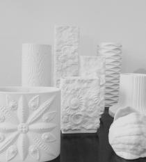 A selection of white biscuit porcelain vases from the 1960s and 70s