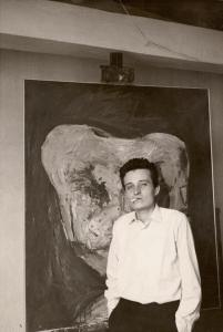 Eugen Sch�nebeck in front of his painting Bildnis Nr. 3, ca. 1962 (destroyed)
