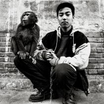 Liu Zheng, From the series The Chinese, A Boy and His Monkey, Beijing, 1994. Deutsche Bank Collection. © Liu Zheng, Courtesy Yossi Milo Gallery, New York