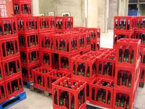 Mike Bouchet, My Cola Lite, 2004, 2000 liter of self produced diet cola, dimensions variable, painted sea container. Installation view Extra City Center of Contemporary Art, Antwerp, Belgium. Courtesy Galerie Parisa Kind, Frankfurt. a. M.