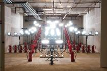 Idan Hayosh, version RUNWAY (Lamps #21), 2012, Installation, Description: Formation of high wattage Strobe lights and fire extinguishers. bursts of flickering light and electric current sound are heard and seen. Lamps are triggered by motion sensors.