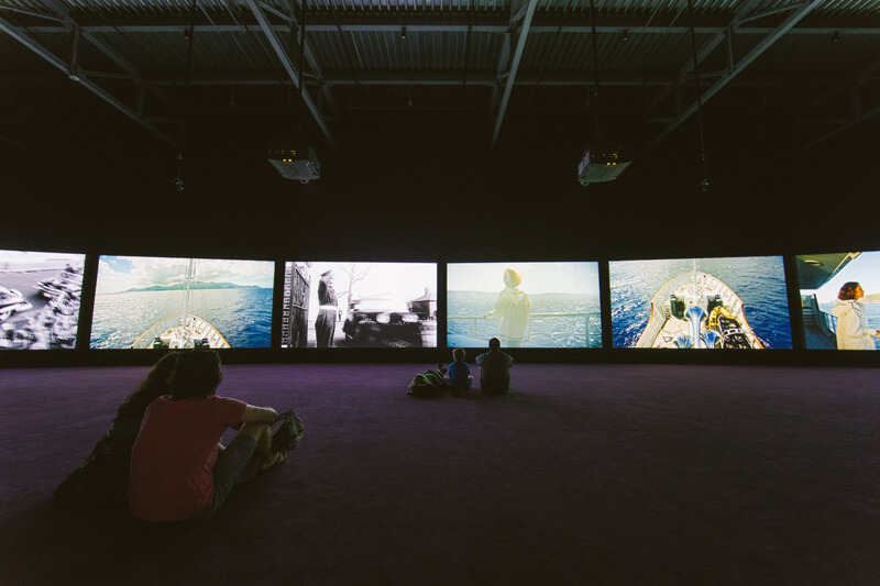 John Akomfrah, Purple, installation view, ICA Watershed, Boston, 2019. Courtesy Lisson Gallery and Museo Nacional Thyssen-Bornemisza. Photo by Meg Elkinton. © Smoking Dogs Films
